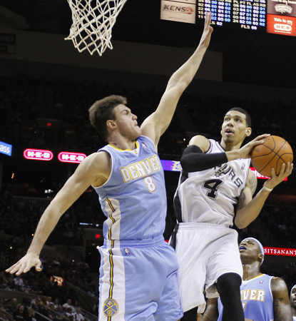 Spurs get leadership from an unlikely source as Danny Green gives them 24 points to help edge the Nuggets. (AP)