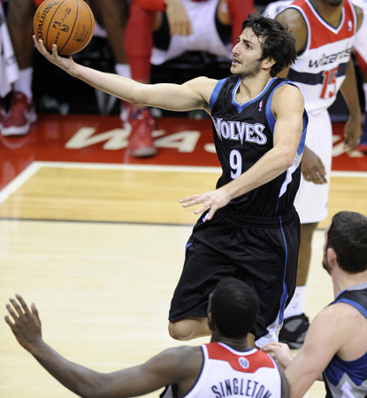 Ricky Rubio drives here for two of his 13 points, and adds a career-high 14 assists. (AP)