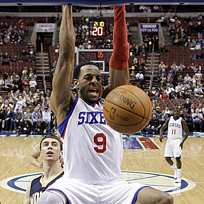 Andre Iguodala dunks home two of his game-high 20 points for the first-place 76ers.  (AP)