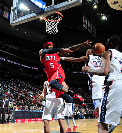 The Hawks' 54 percent shooting and Josh Smith's 26 points carry the team over the Nets.  (Getty Images)