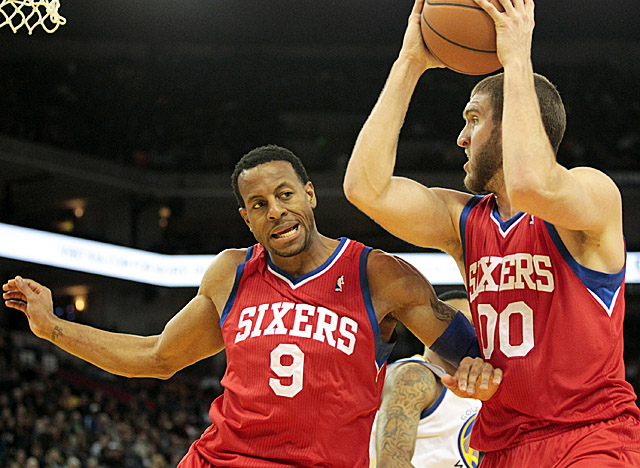 As Spencer Hawes pulls the rebounding load, Andre Iguodala is the one driving the Sixers. (US Presswire)