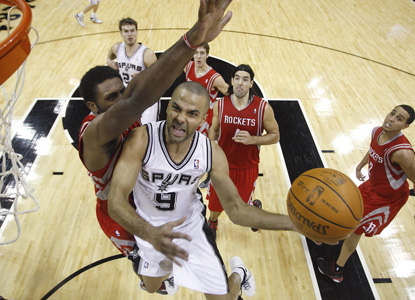 Tony Parker leads the Spurs in an OT win vs. the Rockets with 28 points, and four free throws late to ice it. (AP)