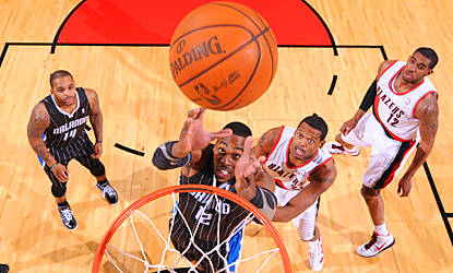 The Magic's Dwight Howard grabs one of his game-high 13 rebounds against the Trail Blazers.  (Getty Images)
