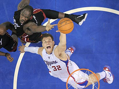 Blake Griffin beats Joel Anthony to a rebound in the first half. Griffin winds up 20 points with 12 boards.  (AP)