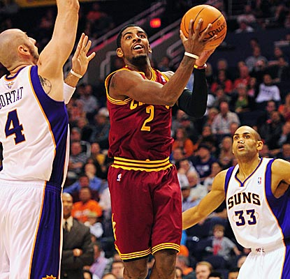 Cavs rookie Kyrie Irving proves himself against Steve Nash, scoring a career-high 26 points.  (US Presswire)