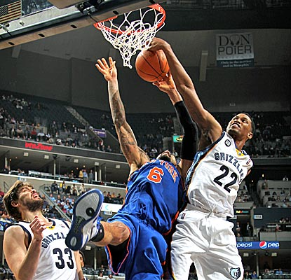 Rudy Gay, seen here blocking Tyson Chandler's shot, scores 26 points against the Knicks.  (Getty Images)