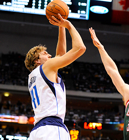Dirk Nowitzki shoots for two of his 11 points, putting him over 23,000 points for his career. (US Presswire)