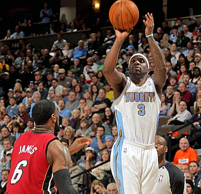 Returning from a sprained right foot, Denver's Ty Lawson scores 24 points and adds nine assists.  (Getty Images)