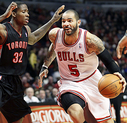 Carlos Boozer is one of three starters for the Bulls that scores in double digits against Toronto. (AP)