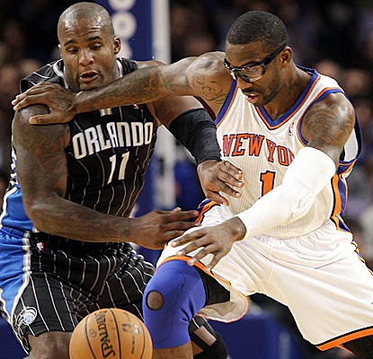 New Magic man Glen Davis helps Orlando's front court limit Amar'e Stoudemire to 10 points and two boards. (Getty Images)