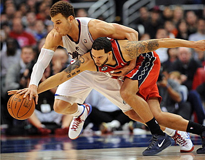 Blake Griffin (23 points, 14 rebounds) battles New Jersey's Deron Williams (14 points) for a loose ball in the Clippers' win. (US Presswire)