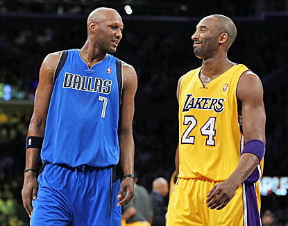 Lamar Odom (left), who finishes with 10 points in his return to Los Angeles, shares a moment with Kobe Bryant. (AP)