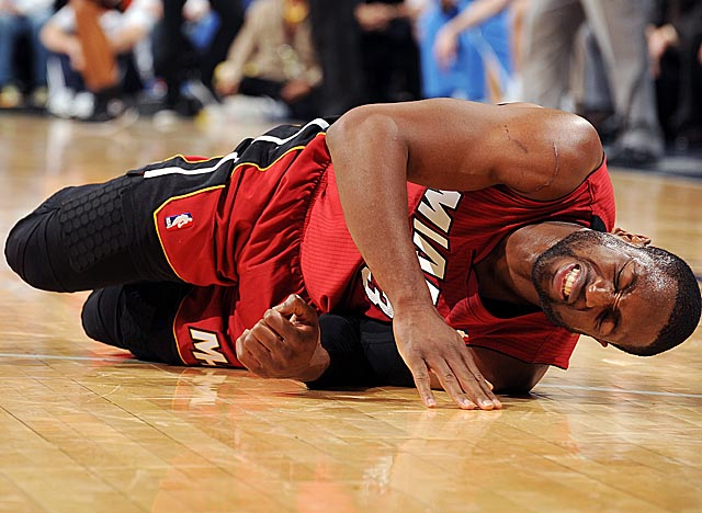 After spraining his left ankle in Denver on Friday, Wade has yet to return to practice. (Getty Images)