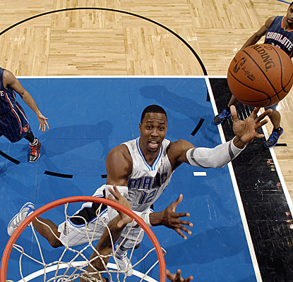 Dwight Howard (25 points and 17 rebounds) carries the Magic over the Bobcats for their fifth straight win. (Getty Images)