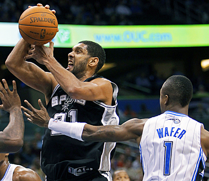 Tim Duncan gets fouled here, but still powers through the Magic for 17 points and 10 rebounds. (AP)