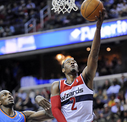 John Wall leads the Wizards with 25 points and also finishes with seven rebounds and eight assists. (AP)