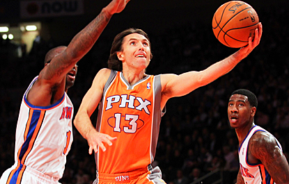 Steve Nash drives for two of his 26 points against the Knicks, who lose their fourth straight game. (US Presswire)