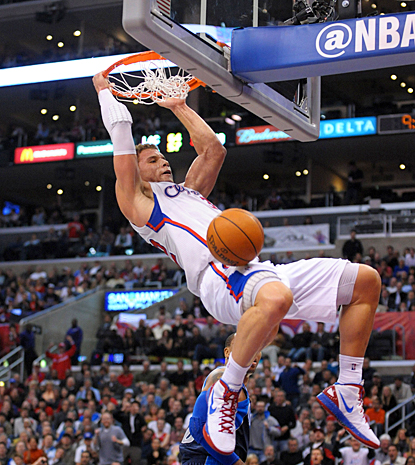 Blake Griffin slams home two of his 14 points to go along with his 17 rebounds against the Mavs. (US Presswire)
