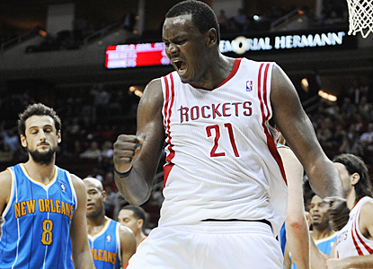 Samuel Dalembert celebrates after scoring a basket for two of his 15 points against the Hornets. (AP)