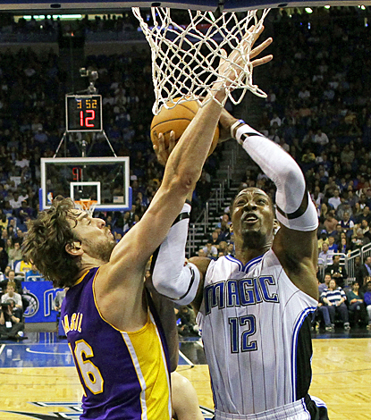 Dwight Howard proves to be no match for the Lakers, scoring 21 points and grabbing 23 rebounds. (AP)