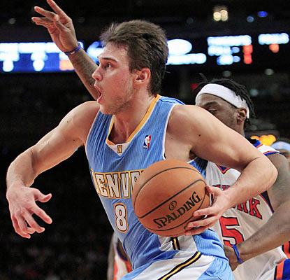 Danilo Gallinari fuels the Nuggets with a career-high 37 points against his former team in a double-overtime victory (AP)