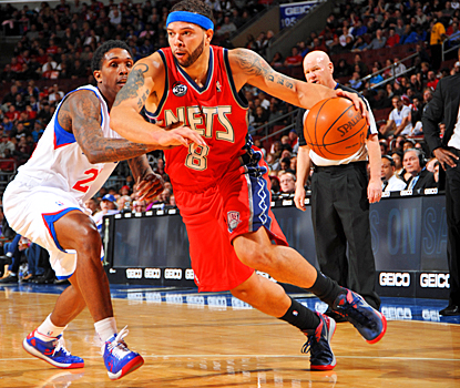 The Sixers are no match for Deron Williams, who scores 34 points with 11 assists for the Nets. (Getty Images)
