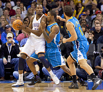 The Thunder's Kevin Durant looks to make a pass during the third quarter against the Hornets. (US Presswire)