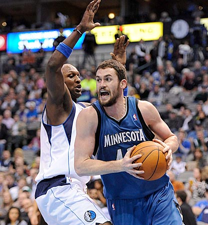 Kevin Love, shown driving around Lamar Odom in the third quarter, registers his 16th consecutive double-double.  (US Presswire)