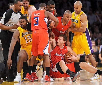 Blake Griffin winds up on the floor as tempers flare between the intra-arena rivals in the second half.  (US Presswire)