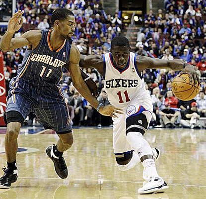 Philadelphia's Jrue Holiday (right) scores 15 in the 76ers' 89-72 win over the Bobcats. (AP)