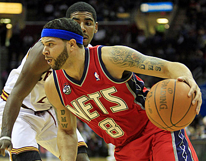 New Jersey's Deron Williams (right) drives past Cleveland's Kyrie Irving while scoring 27 points in the Nets' win. (AP)