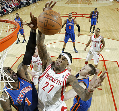 Jordan Hill pulls down one of his 11 rebounds over Amare Stoudemire. Hill also scores 14 as Houston improves to 9-2 at home. (Getty Images)
