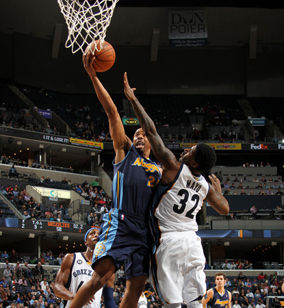 O.J. Mayo's trey in overtime caps his 18-point night and gets the Grizzlies past the Nuggets.  (Getty Images)