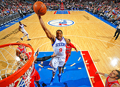 Andre Iguodala flies over the Bulls' defense for 19 points and nine rebounds in the Sixers' win. (Getty Images)