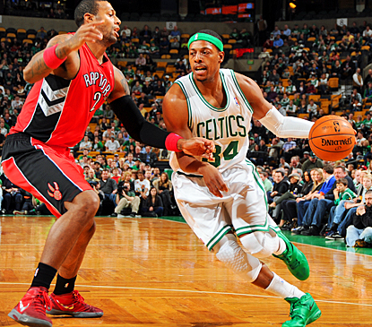 Boston's Paul Pierce drives around Toronto's James Johnson during the second quarter. (Getty Images)