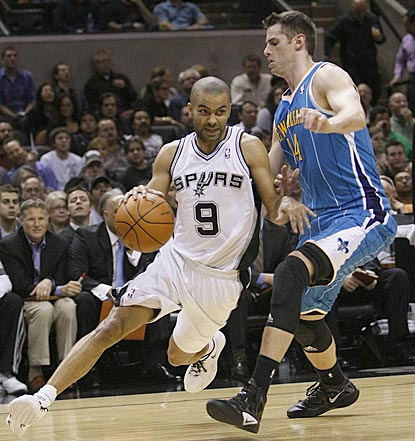 Tony Parker, on his way to an 18-point evening, drives his way around Jason Smith in the first half.  (US Presswire)