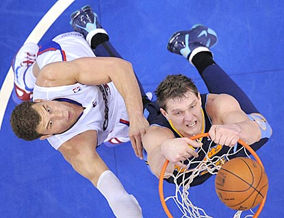 Now a Denver Nugget, Timofey Mozgov (right) gets the better of Blake Griffin in this matchup.  (AP)