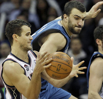 Nikola Pekovic (right) gets in the mix for the Timberwolves, scoring a career-high 27 points and grabbing 11 rebounds.  (AP)