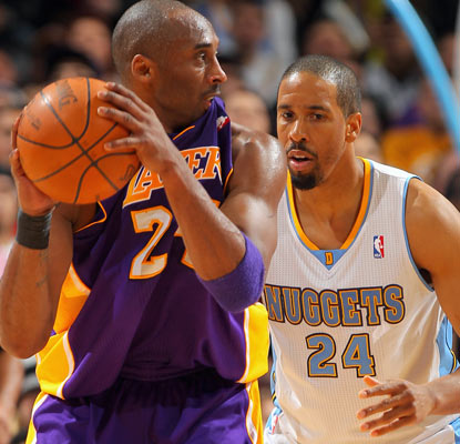 Kobe Bryant (20 points) and the Lakers notch a rare road win by slipping past Andre Miller and the Nuggets.  (Getty Images)