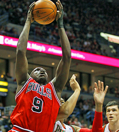 The Bulls' Luol Deng drives to the basket for two of his 21 points in his return against the Bucks. (AP)