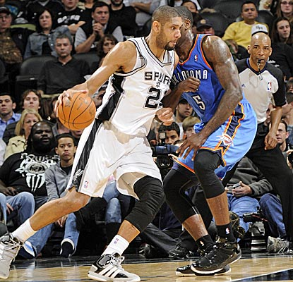 Tim Duncan grabs 15 boards, and fittingly, is the recipient of Tony Parker's record-breaking assist.  (Getty Images)