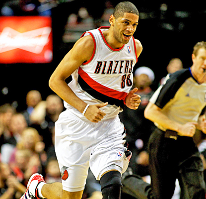 Nicolas Batum smiles after drilling one of his nine 3-pointers to set a new Trail Blazers record. (US Presswire)