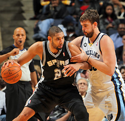 Marc Gasol struggles to slow down Tim Duncan, who puts up 19 points -- including 13 in the second half -- and 17 rebounds. (Getty Images)