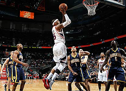Josh Smith contributes 28 points and 12 rebounds for Atlanta, which ends a three-game home losing skid. (Getty Images)