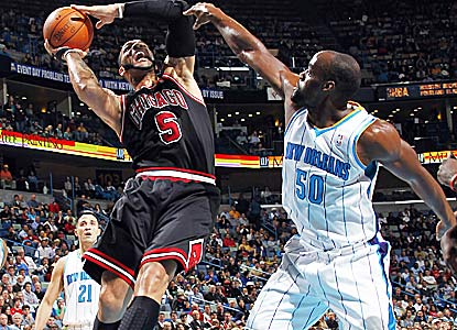 Carlos Boozer scores 18 for the Bulls, who receive only six from star guard Derrick Rose in the rout.  (Getty Images)
