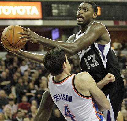 Tyreke Evans drives to the basket over Nick Collison, as the Kings guard finishes with 22 points on the night. (AP)
