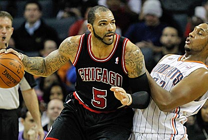 With Derrick Rose out, the Bulls run their offense through Carlos Boozer, who scores 16 points.  (Getty Images)