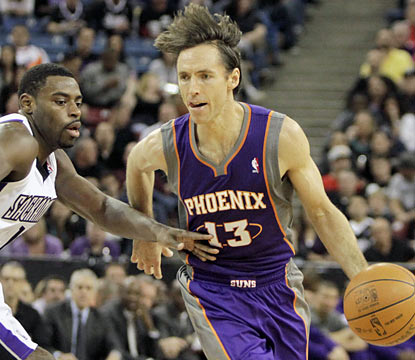 Steve Nash does most of his damage finding open teammates as he finishes with 15 assists in the win. (AP)