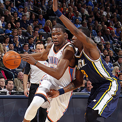 The Thunder's Kevin Durant blows by the Jazz's Josh Howard for two of his 21 points.  (Getty Images)