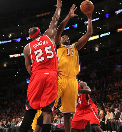 Andrew Bynum goes up for two of his 15 points, and adds 15 boards to help the Lakers top the Hawks. (Getty Images)